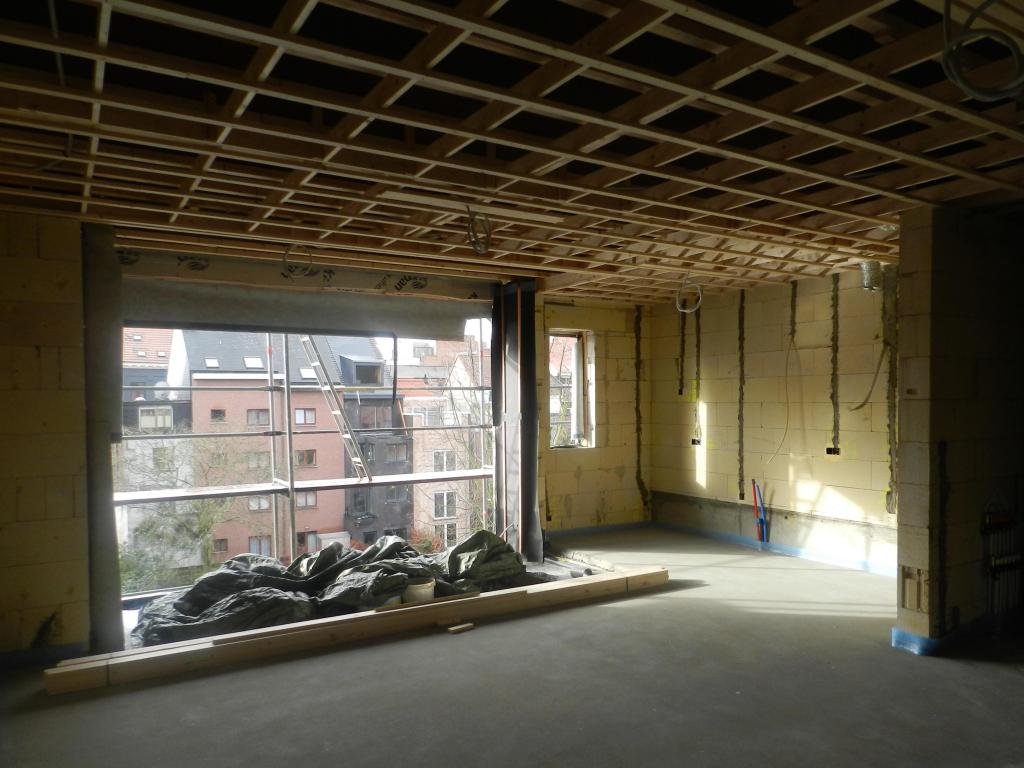 - Living room and kitchen during the construction